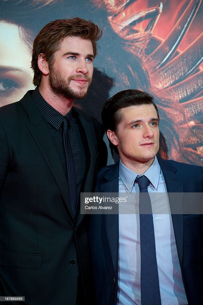 Actors <a gi-track='captionPersonalityLinkClicked' href=/galleries/search?phrase=Liam+Hemsworth&family=editorial&specificpeople=6338547 ng-click='$event.stopPropagation()'>Liam Hemsworth</a> (L) and <a gi-track='captionPersonalityLinkClicked' href=/galleries/search?phrase=Josh+Hutcherson&family=editorial&specificpeople=673588 ng-click='$event.stopPropagation()'>Josh Hutcherson</a> (R) attend the Spanish premiere of the film 'The Hunger Games - Catching Fire' (Los Juegos Del Hambre: En Llamas) at the Callao cinema on November 13, 2013 in Madrid, Spain.