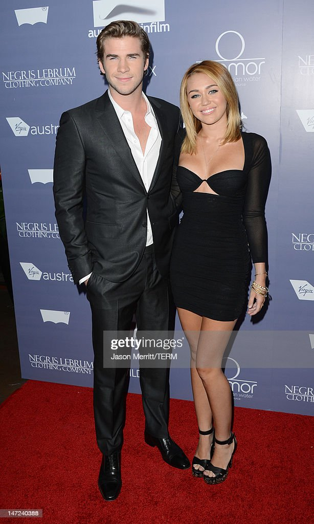 Actors <a gi-track='captionPersonalityLinkClicked' href=/galleries/search?phrase=Liam+Hemsworth&family=editorial&specificpeople=6338547 ng-click='$event.stopPropagation()'>Liam Hemsworth</a> and <a gi-track='captionPersonalityLinkClicked' href=/galleries/search?phrase=Miley+Cyrus&family=editorial&specificpeople=3973523 ng-click='$event.stopPropagation()'>Miley Cyrus</a> arrive at Australians In Film Awards & Benefit Dinner at InterContinental Hotel on June 27, 2012 in Century City, California.