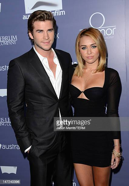 Actors Liam Hemsworth and Miley Cyrus arrive at Australians In Film Awards Benefit Dinner at InterContinental Hotel on June 27 2012 in Century City...
