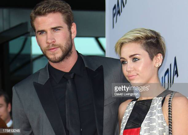 Actors Liam Hemsworth and Miley Cyrus attend the premiere of Relativity Media's 'Paranoia' at the DGA Theater on August 8 2013 in Los Angeles...