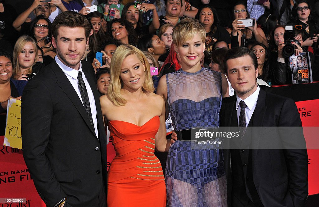 Actors Liam Hemsworth, Elizabeth Banks, Jennifer Lawrence and Josh Hutcherson arrive at the Los Angeles prremiere of 'The Hunger Games: Catching Fire' at Nokia Theatre L.A. Live on November 18, 2013 in Los Angeles, California.