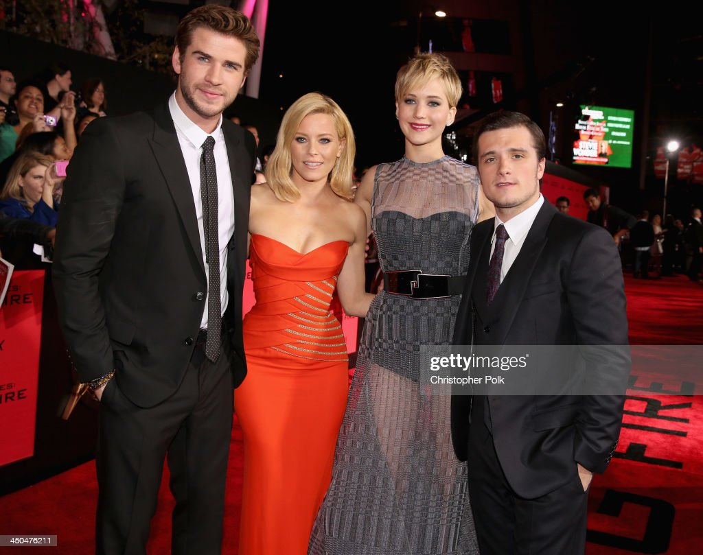 Actors <a gi-track='captionPersonalityLinkClicked' href=/galleries/search?phrase=Liam+Hemsworth&family=editorial&specificpeople=6338547 ng-click='$event.stopPropagation()'>Liam Hemsworth</a>, <a gi-track='captionPersonalityLinkClicked' href=/galleries/search?phrase=Elizabeth+Banks&family=editorial&specificpeople=202475 ng-click='$event.stopPropagation()'>Elizabeth Banks</a>, <a gi-track='captionPersonalityLinkClicked' href=/galleries/search?phrase=Jennifer+Lawrence&family=editorial&specificpeople=1596040 ng-click='$event.stopPropagation()'>Jennifer Lawrence</a> and <a gi-track='captionPersonalityLinkClicked' href=/galleries/search?phrase=Josh+Hutcherson&family=editorial&specificpeople=673588 ng-click='$event.stopPropagation()'>Josh Hutcherson</a> attend premiere of Lionsgate's 'The Hunger Games: Catching Fire' - Red Carpet at Nokia Theatre L.A. Live on November 18, 2013 in Los Angeles, California.
