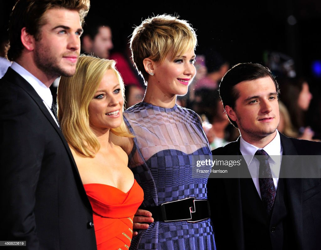 Actors Liam Hemsworth, Elizabeth Banks, Jennifer Lawrence, Josh Hutcherson attend the premiere of Lionsgate's 'The Hunger Games: Cathching Fire' at Nokia Theatre L.A. Live on November 18, 2013 in Los Angeles, California.