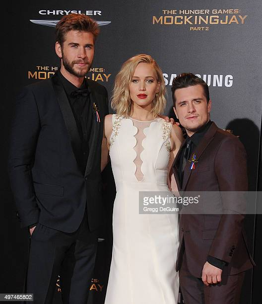 Actors Liam Hemsworth Jennifer Lawrence and Josh Hutcherson arrive at the premiere of Lionsgate's 'The Hunger Games Mockingjay Part 2' at Microsoft...