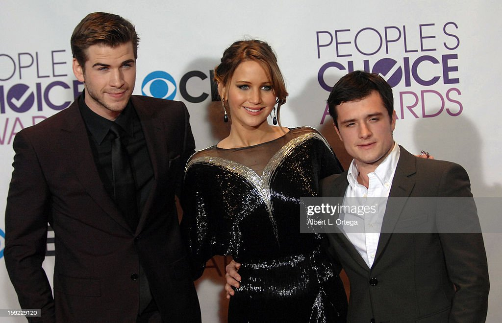Actors Liam Hemsworth, Jennifer Lawrence and Josh Hutcherson participate at the 39th Annual People's Choice Awards - Press Room held at Nokia Theater L.A. Live on January 9, 2013 in Los Angeles, California.