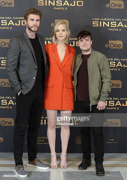 Actors Liam Hemsworth Jennifer Lawrence and Josh Hutcherson attend a photocall for 'The Hunger Games Mockingjay Part 2' at the Villamagna Hotel on...