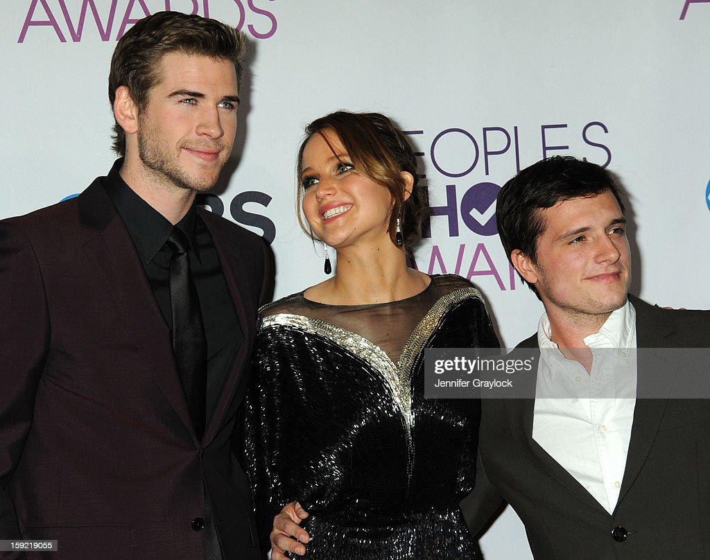 Actors Liam Hemsworth, Jennifer Lawrence and Josh Hutcherson attend the 2013 People's Choice Awards Press Room held at Nokia Theatre L.A. Live on January 9, 2013 in Los Angeles, California.