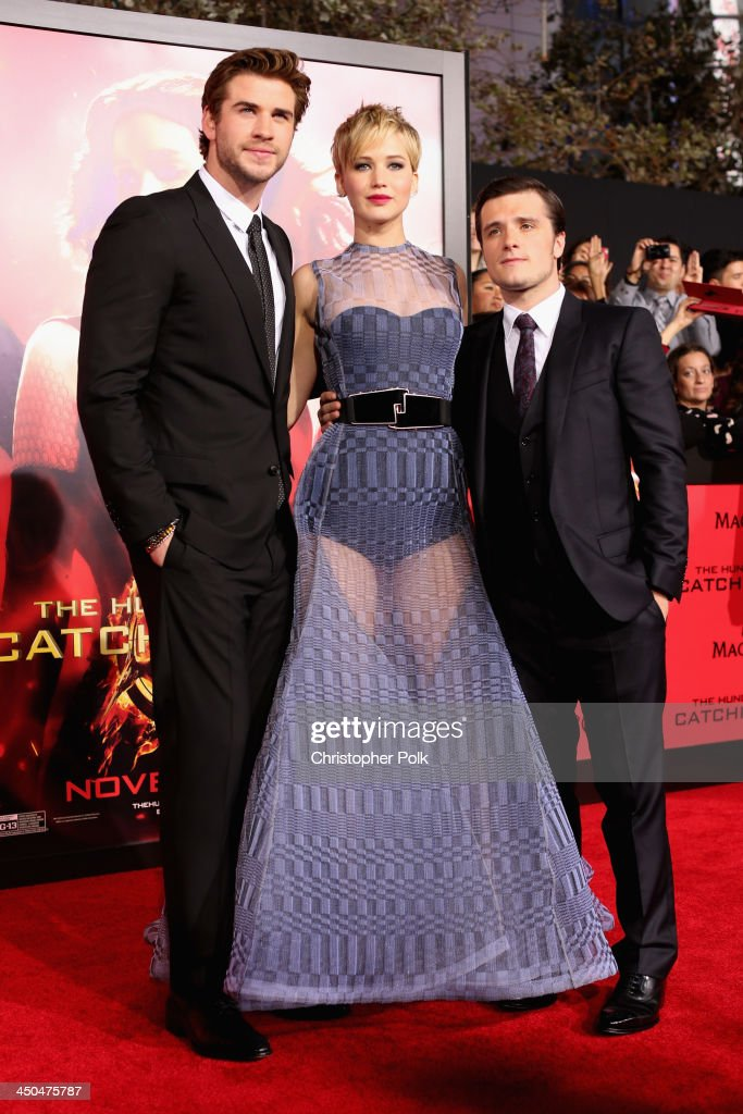 Actors <a gi-track='captionPersonalityLinkClicked' href=/galleries/search?phrase=Liam+Hemsworth&family=editorial&specificpeople=6338547 ng-click='$event.stopPropagation()'>Liam Hemsworth</a>, <a gi-track='captionPersonalityLinkClicked' href=/galleries/search?phrase=Jennifer+Lawrence&family=editorial&specificpeople=1596040 ng-click='$event.stopPropagation()'>Jennifer Lawrence</a> and <a gi-track='captionPersonalityLinkClicked' href=/galleries/search?phrase=Josh+Hutcherson&family=editorial&specificpeople=673588 ng-click='$event.stopPropagation()'>Josh Hutcherson</a> attend premiere of Lionsgate's 'The Hunger Games: Catching Fire' - Red Carpet at Nokia Theatre L.A. Live on November 18, 2013 in Los Angeles, California.