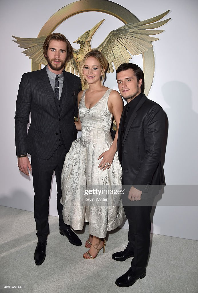 Actors Liam Hemsworth Jennifer Lawrence and Josh Hutcherson attend the premiere of Lionsgate's 'The Hunger Games Mockingjay Part 1' at Nokia Theatre...