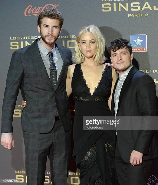 Actors Liam Hemsworth Jennifer Lawrence and Josh Hutcherson attend 'The Hunger Games Mockingjay Part 2' Madrid Premiere at Kinepolis Cinema on...