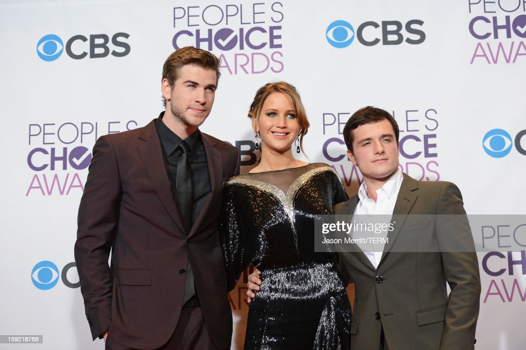 Actors Liam Hemsworth, Jennifer Lawrence and Josh Hutcherson of Favorite Movie winner 'The Hunger Games' pose in the press room at the 39th Annual People's Choice Awards at Nokia Theatre L.A. Live on January 9, 2013 in Los Angeles, California.