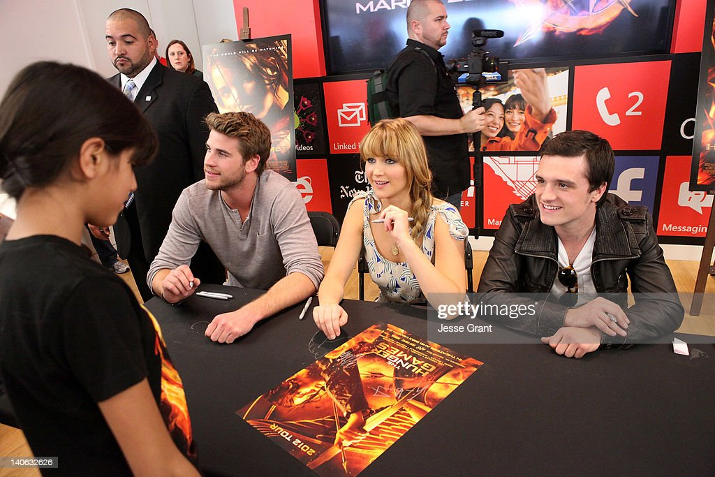Actors Liam Hemsworth Jennifer Lawrence and Josh Hutcherson sign autographs for fans during The Hunger Games US Mall Tour KickOff at Westfield...