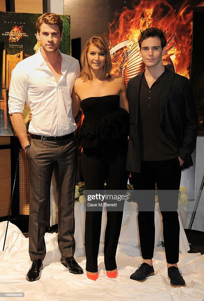 Actors <a gi-track='captionPersonalityLinkClicked' href=/galleries/search?phrase=Liam+Hemsworth&family=editorial&specificpeople=6338547 ng-click='$event.stopPropagation()'>Liam Hemsworth</a>, <a gi-track='captionPersonalityLinkClicked' href=/galleries/search?phrase=Jennifer+Lawrence&family=editorial&specificpeople=1596040 ng-click='$event.stopPropagation()'>Jennifer Lawrence</a> and <a gi-track='captionPersonalityLinkClicked' href=/galleries/search?phrase=Sam+Claflin&family=editorial&specificpeople=7238693 ng-click='$event.stopPropagation()'>Sam Claflin</a> attend The Hunger Games: Catching Fire photocall at the 2013 Cannes Film Festival at Majestic Barierre on May 18, 2013 in Cannes, France.
