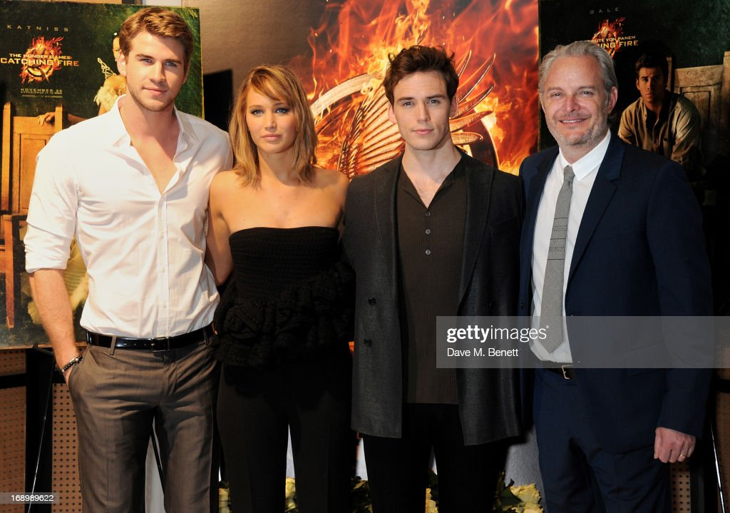 Actors <a gi-track='captionPersonalityLinkClicked' href=/galleries/search?phrase=Liam+Hemsworth&family=editorial&specificpeople=6338547 ng-click='$event.stopPropagation()'>Liam Hemsworth</a>, <a gi-track='captionPersonalityLinkClicked' href=/galleries/search?phrase=Jennifer+Lawrence&family=editorial&specificpeople=1596040 ng-click='$event.stopPropagation()'>Jennifer Lawrence</a>, <a gi-track='captionPersonalityLinkClicked' href=/galleries/search?phrase=Sam+Claflin&family=editorial&specificpeople=7238693 ng-click='$event.stopPropagation()'>Sam Claflin</a> and director <a gi-track='captionPersonalityLinkClicked' href=/galleries/search?phrase=Francis+Lawrence&family=editorial&specificpeople=224820 ng-click='$event.stopPropagation()'>Francis Lawrence</a> attend The Hunger Games: Catching Fire photocall at the 2013 Cannes Film Festival at Majestic Barierre on May 18, 2013 in Cannes, France.