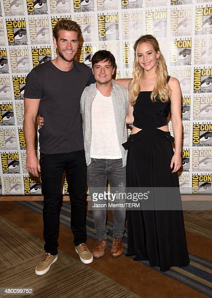 Actors Liam Hemsworth Josh Hutcherson and Jennifer Lawrence of 'The Hunger Games Mockingjay Part 2' attends the Lionsgate press room during ComicCon...