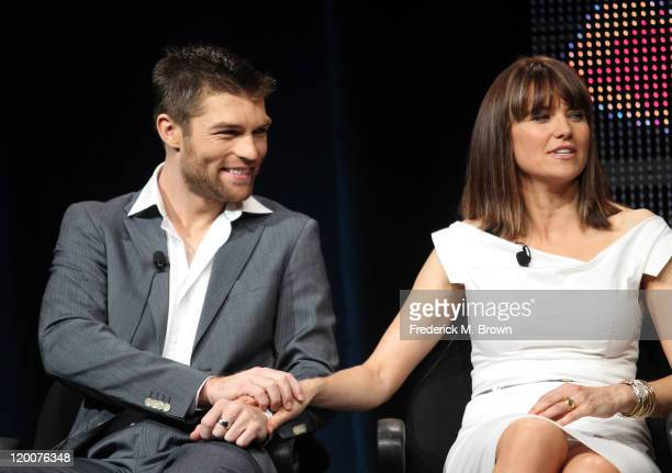 Actors Liam Mcintyre and Lucy Lawless speak during the 'Spartacus Vengeance' panel during the Starz portion of the 2011 Summer TCA Tour held at the...