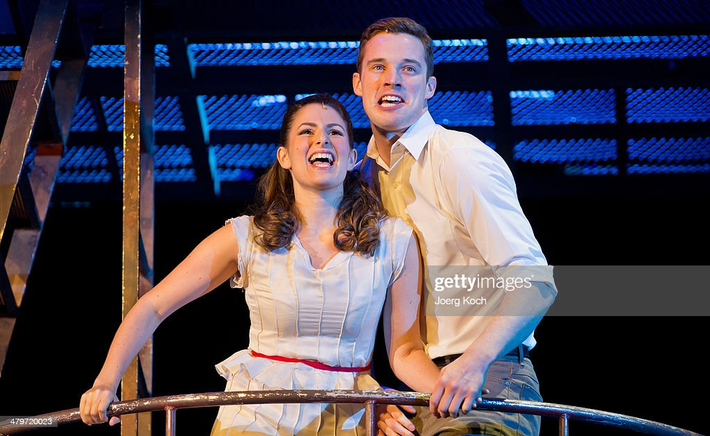 Actors Liam Tobin (as Tony) and Rachel Zatcoff (as Maria) sing during a photocall for the musical 'West Side Story' at Deutsches Theatre on March 20, 2014 in Munich, Germany.