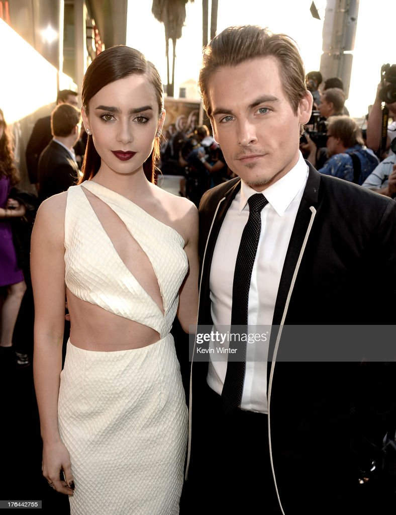 Actors <a gi-track='captionPersonalityLinkClicked' href=/galleries/search?phrase=Lily+Collins&family=editorial&specificpeople=3520243 ng-click='$event.stopPropagation()'>Lily Collins</a> (L) and <a gi-track='captionPersonalityLinkClicked' href=/galleries/search?phrase=Kevin+Zegers&family=editorial&specificpeople=622283 ng-click='$event.stopPropagation()'>Kevin Zegers</a> arrive at the premiere of Screen Gems & Constantin Films' 'The Mortal Instruments: City Of Bones' at the Cinerama Dome Theatre on August 12, 2013 in Los Angeles, California.