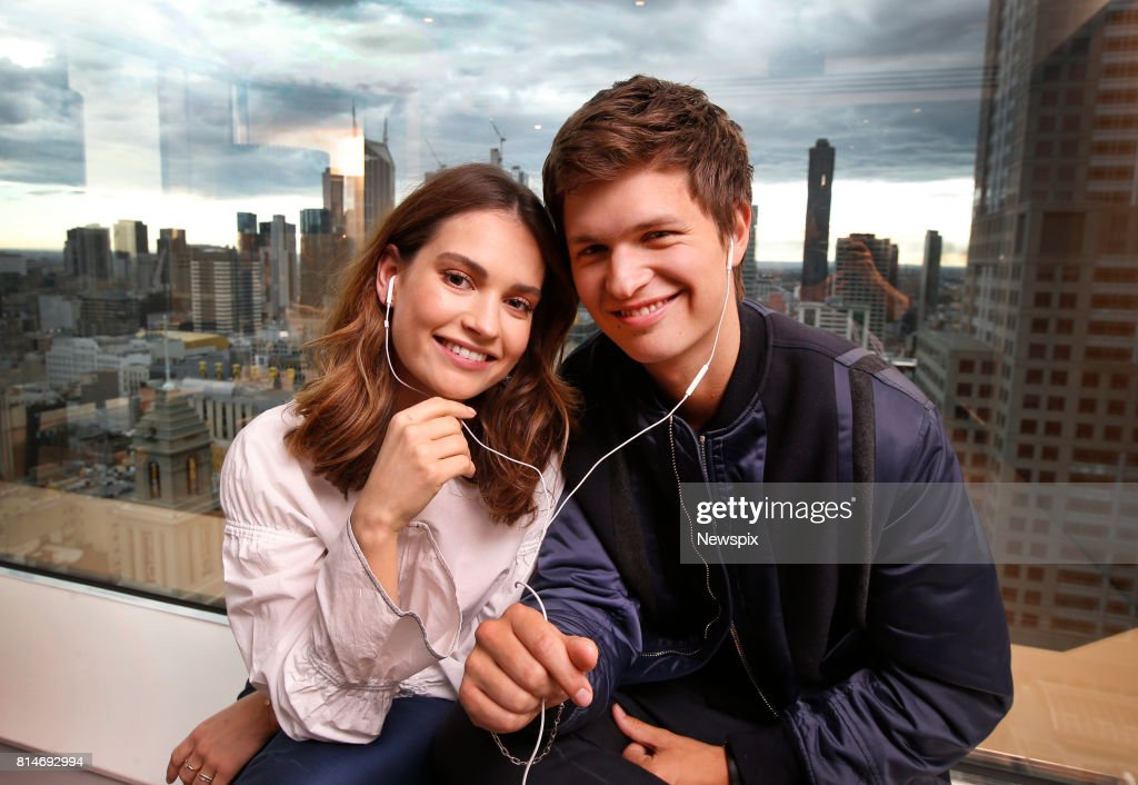 MELBOURNE, VIC - (EUROPE AND AUSTRALASIA OUT) (L-R) Actors Lily James and Ansel Elgort listen to music during a photo shoot in Melbourne, Victoria.