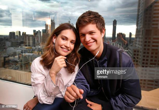 MELBOURNE VIC Actors Lily James and Ansel Elgort listen to music during a photo shoot in Melbourne Victoria