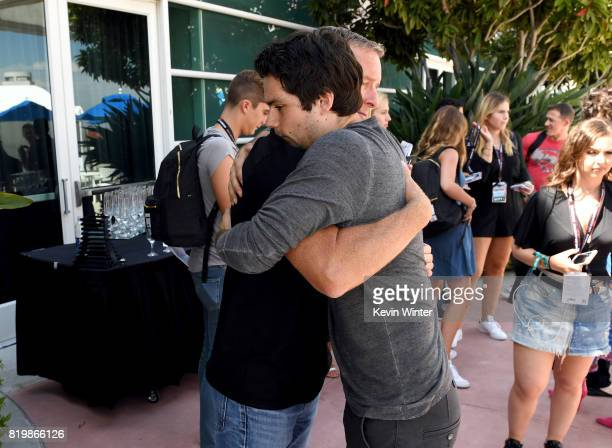 Actors Linden Ashby and Dylan O'Brien from 'Teen Wolf' celebrate their final season backstage after their Hall H panel during ComicCon International...