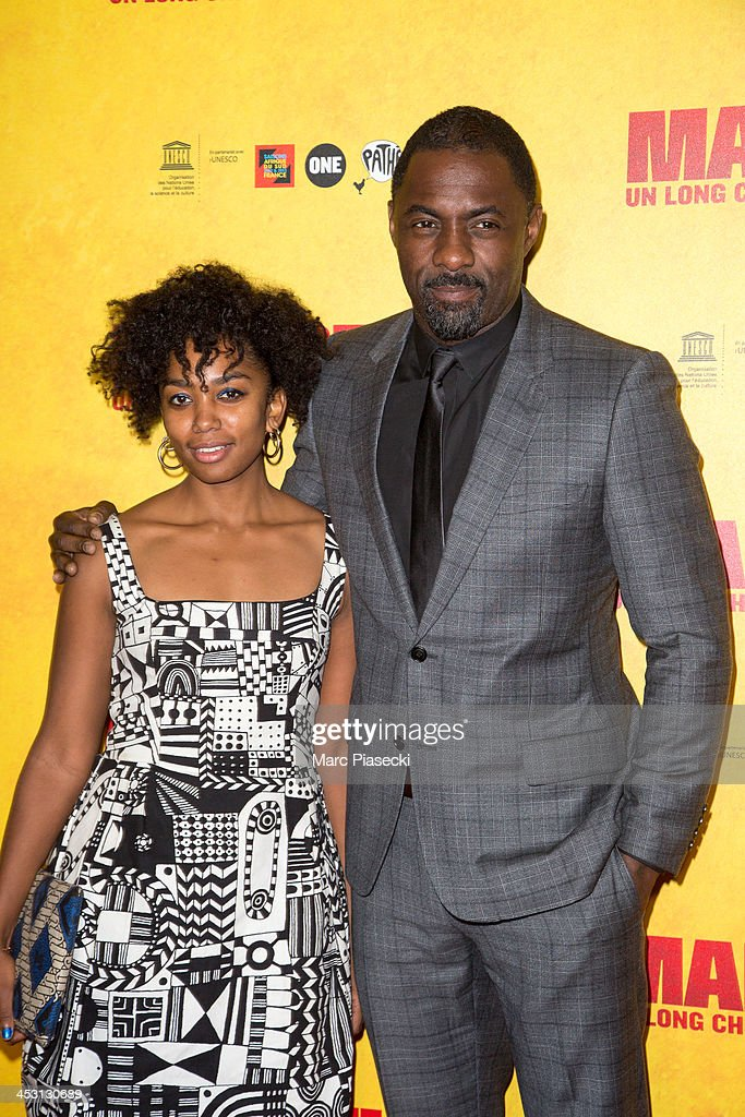 Actors Lindiwe Matshikiza and <a gi-track='captionPersonalityLinkClicked' href=/galleries/search?phrase=Idris+Elba&family=editorial&specificpeople=215443 ng-click='$event.stopPropagation()'>Idris Elba</a> attend the 'Mandela: Long Walk to Freedom' Paris premiere at UNESCO on December 2, 2013 in Paris, France.
