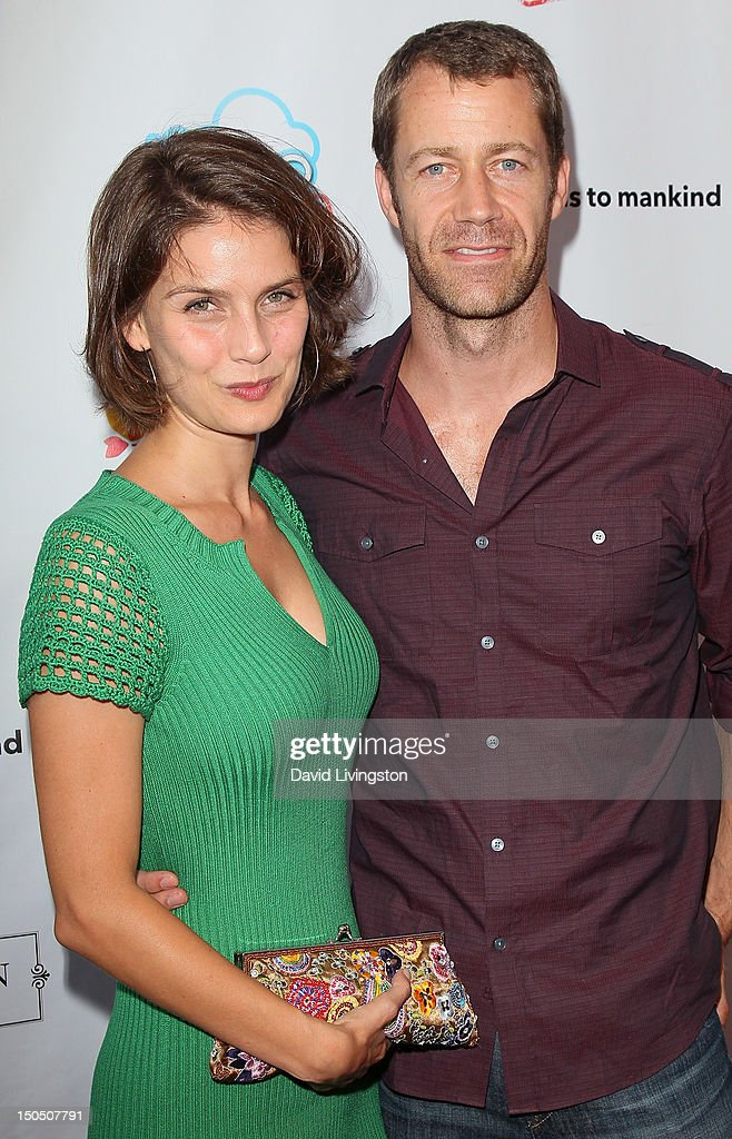 Actors Lindsay Thompson (L) and Colin Ferguson attend Friends to Mankind's 2nd annual 18 For 18 charity event and fundraiser 'The Jump' benefitting the Somaly Mam Foundation at Lexington Social House on August 19, 2012 in Hollywood, California.