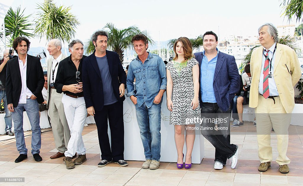 Actors Liron Levo, Heinz Lieven, Judd Hirsh, Director Paolo Sorrentino, Sean Penn, Eve Hewson and Simon Delaney attend the 'This Must Be The Place' photocall during the 64th Annual Cannes Film Festival at Palais des Festivals on May 20, 2011 in Cannes, France.