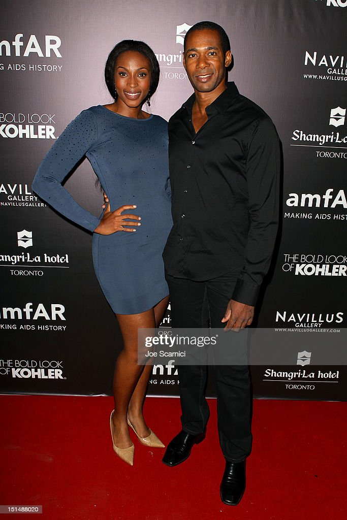 Actors Lisa Berry (L) and Dion Johnstone attend amfAR Cinema Against AIDS TIFF 2012 during the 2012 Toronto International Film Festival at Shangri-La Hotel on September 7, 2012 in Toronto, Canada.