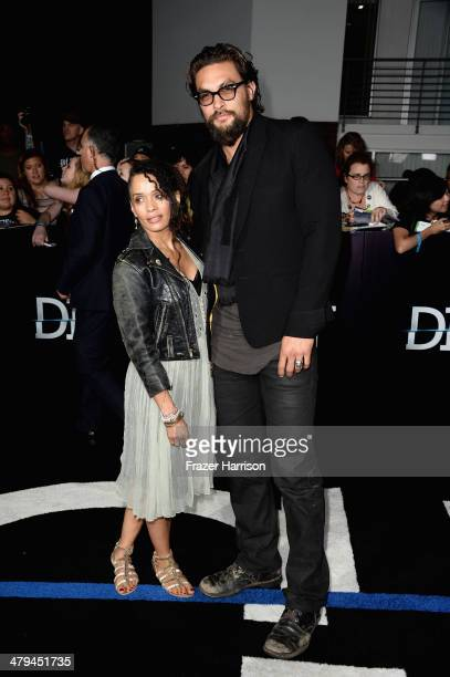 Actors Lisa Bonet and Jason Momoa arrive at the premiere of Summit Entertainment's 'Divergent' at the Regency Bruin Theatre on March 18 2014 in Los...