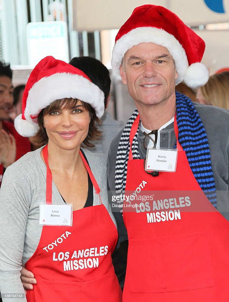 Actors Lisa Rinna (L) and Harry Hamlin attend the Los Angeles Mission's Christmas Eve for the homeless at the Los Angeles Mission on December 24, 2012 in Los Angeles, California.