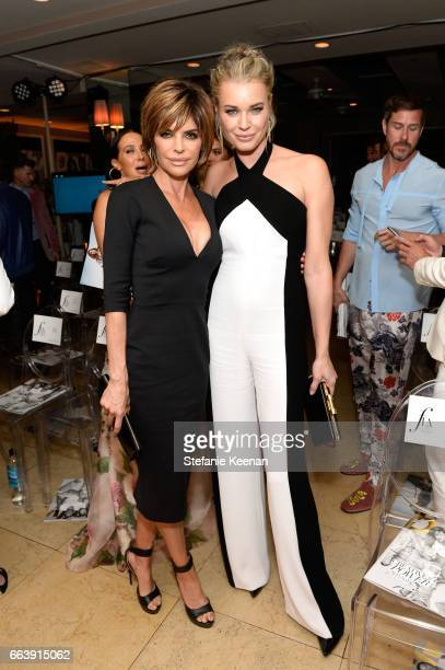 Actors Lisa Rinna and Rebecca Romijn attend the Daily Front Row's 3rd Annual Fashion Los Angeles Awards at Sunset Tower Hotel on April 2 2017 in West...