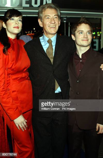Actors Liv Tyler Ian McKellen and Elijah Wood arrive at the Odeon Leicester Square in London for the world premiere of their new film Lord of the...