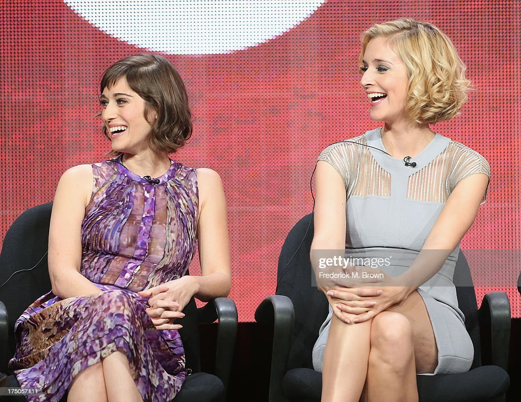 Actors <a gi-track='captionPersonalityLinkClicked' href=/galleries/search?phrase=Lizzy+Caplan&family=editorial&specificpeople=599560 ng-click='$event.stopPropagation()'>Lizzy Caplan</a> and Caitlin Fitzgerald speak onstage during the 'Masters of Sex' panel discussion at the CBS, Showtime and The CW portion of the 2013 Summer Television Critics Association tour at the Beverly Hilton Hotel on July 30, 2013 in Beverly Hills, California.