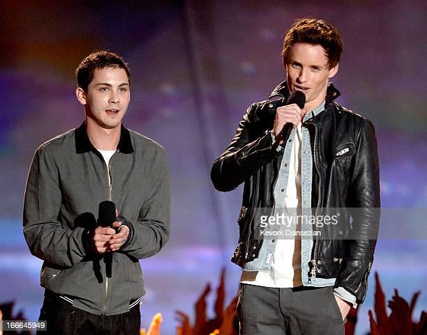 Actors Logan Lerman and Eddie Redmayne speak onstage during the 2013 MTV Movie Awards at Sony Pictures Studios on April 14 2013 in Culver City...