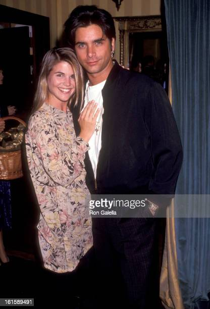 Actors Lori Loughlin and John Stamos attend the Party to Celebrate the Launch of Revlon's New Perfume 'Spellbound' on September 30 1991 at Club Tatou...