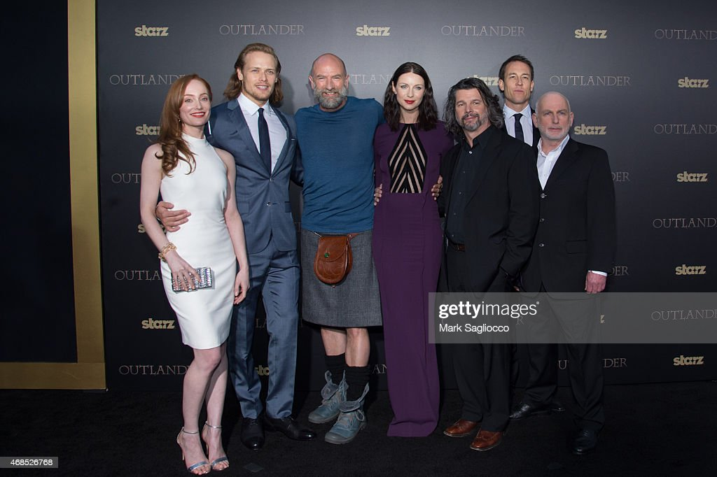 Actors Lotte Verbeek, Sam Heughan, Caitriona Balfe, Graham McTavish, Ronald D. Moore, Tobias Menzies and Gary Lewis attend the 'Outlander' Mid-Season Premiere at the Ziegfeld Theater on April 1, 2015 in New York City.