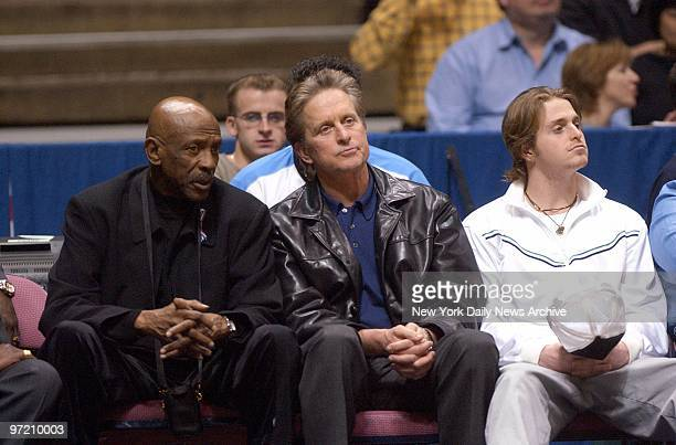 Actors Lou Gossett Jr Michael Douglas and son Cameron Douglas watch as the New Jersey Nets defeat the Miami Heat 9778 at the Continental Airlines...