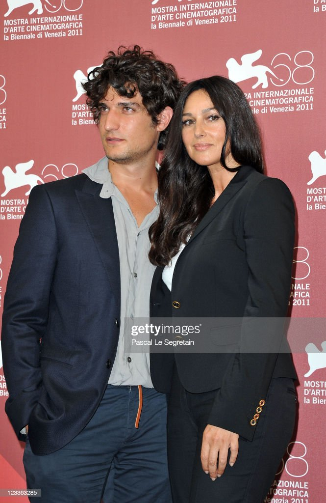 Actors <a gi-track='captionPersonalityLinkClicked' href=/galleries/search?phrase=Louis+Garrel&family=editorial&specificpeople=868484 ng-click='$event.stopPropagation()'>Louis Garrel</a> and <a gi-track='captionPersonalityLinkClicked' href=/galleries/search?phrase=Monica+Bellucci&family=editorial&specificpeople=204777 ng-click='$event.stopPropagation()'>Monica Bellucci</a> pose at the 'Un Ete Brulant' photocall at the Palazzo del Cinema during the 68th Venice Film Festival on September 2, 2011 in Venice, Italy.