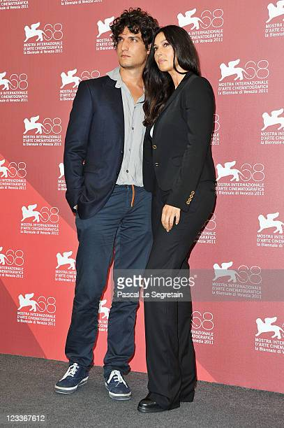 Actors Louis Garrel and Monica Bellucci pose at the 'Un Ete Brulant' photocall at the Palazzo del Cinema during the 68th Venice Film Festival on...