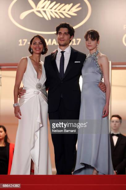 Actors Louis Garrel Berenice Bejo and Stacy Martin attend the 'Redoubtable ' premiere during the 70th annual Cannes Film Festival at Palais des...