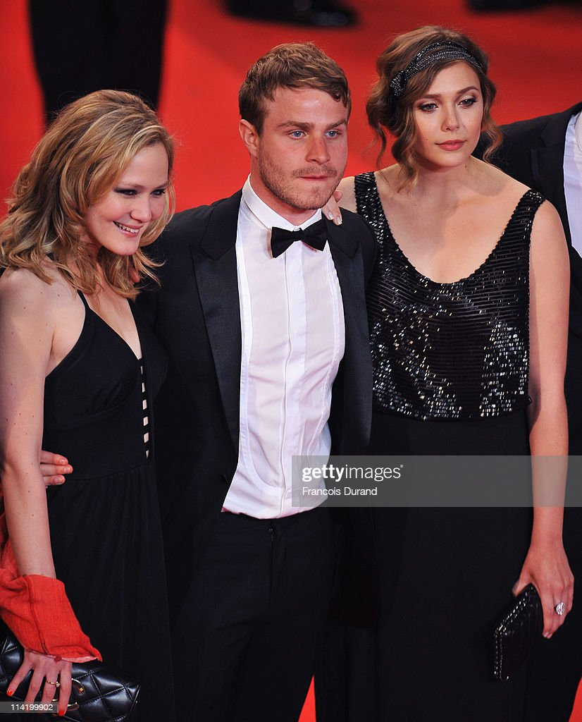 Actors Louisa Krause, Brady Corbet and actress Elizabeth Olsen attend the 'Martha Marcy May Marlene' premiere during the 64th Cannes Film Festival at the Palais des Festivals on May 15, 2011 in Cannes, France.