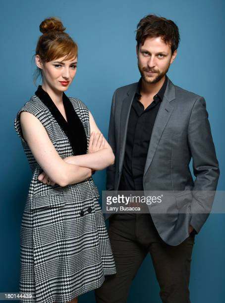 Actors Louise Bourgoin and Pierre Rochefort of 'Going Away' pose at the Guess Portrait Studio during 2013 Toronto International Film Festival on...