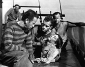 Actors LR Humphrey Bogart Helmut Dantine Billy Roy and George Tobias pose for a publicity still for the Warner Bros film 'Passage to Marseille' in...