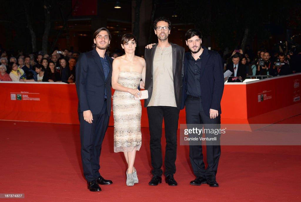 Actors <a gi-track='captionPersonalityLinkClicked' href=/galleries/search?phrase=Luca+Marinelli&family=editorial&specificpeople=7179366 ng-click='$event.stopPropagation()'>Luca Marinelli</a>, actress <a gi-track='captionPersonalityLinkClicked' href=/galleries/search?phrase=Camilla+Filippi&family=editorial&specificpeople=4184165 ng-click='$event.stopPropagation()'>Camilla Filippi</a>, director Alessandro Lunardelli and actor Filippo Scicchitano attend 'Il Mondo Fino In Fondo' Premiere during The 8th Rome Film Festival on November 8, 2013 in Rome, Italy.