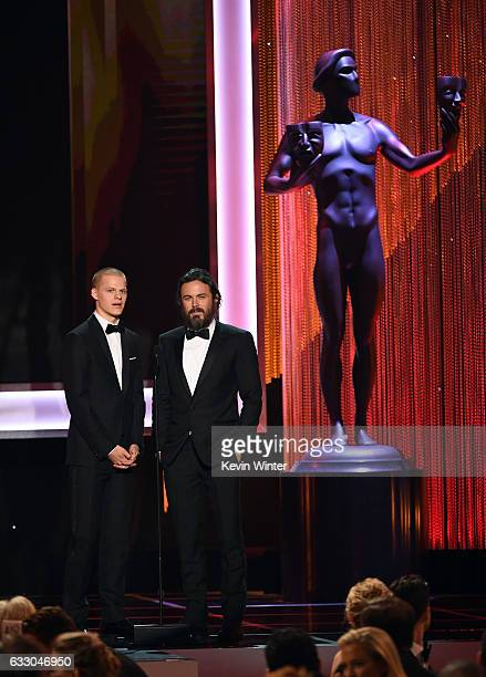 Actors Lucas Hedges and Casey Affleck speak onstage during The 23rd Annual Screen Actors Guild Awards at The Shrine Auditorium on January 29 2017 in...