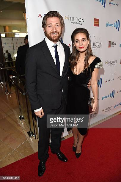 Actors Lucas Neff and Caitlin Stasey attend the 25th Annual GLAAD Media Awards at The Beverly Hilton Hotel on April 12 2014 in Los Angeles California