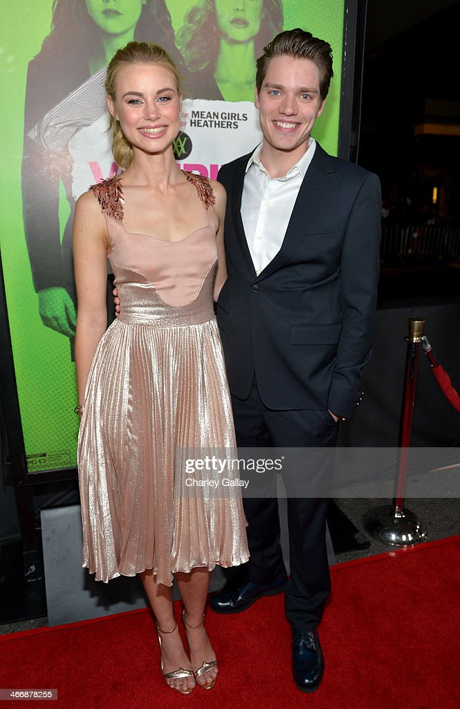 Actors Lucy Fry (L) and Dominic Sherwood arrive at The Weinstein Company's premiere of 'Vampire Academy' at Regal 14 at L.A. Live Downtown on February 4, 2014 in Los Angeles, California.