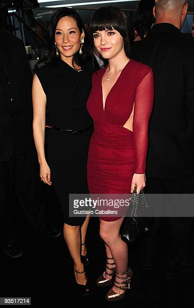 Actors Lucy Liu and Christina Ricci attends 'The Art of Progress' world premiere of the new Audi A8 at the Audi Pavilion on November 30 2009 in Miami...