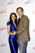 Actors Lucy Liu and Dylan Baker attend a photo call as part of the new cast of 'God Of Carnage' at Sardi's on February 16 2010 in New York City